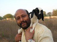 pastor-john-and-lamb.JPG